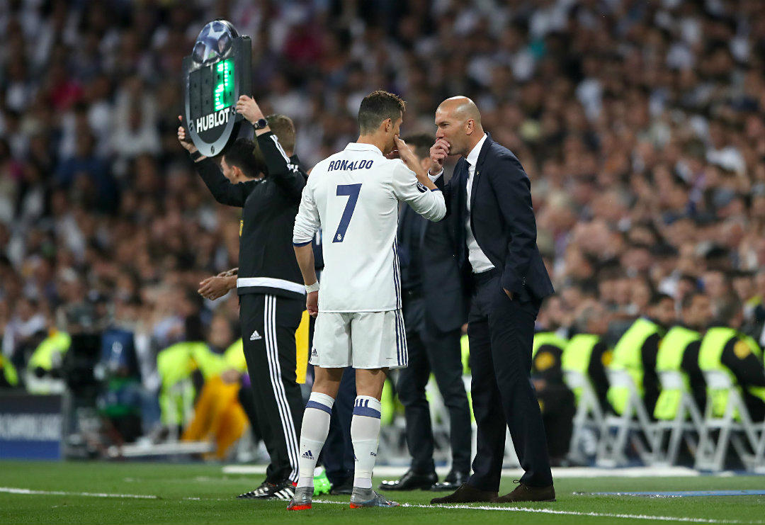 real-madrids-cristiano-ronaldo-with-manager-zinedine-zidane